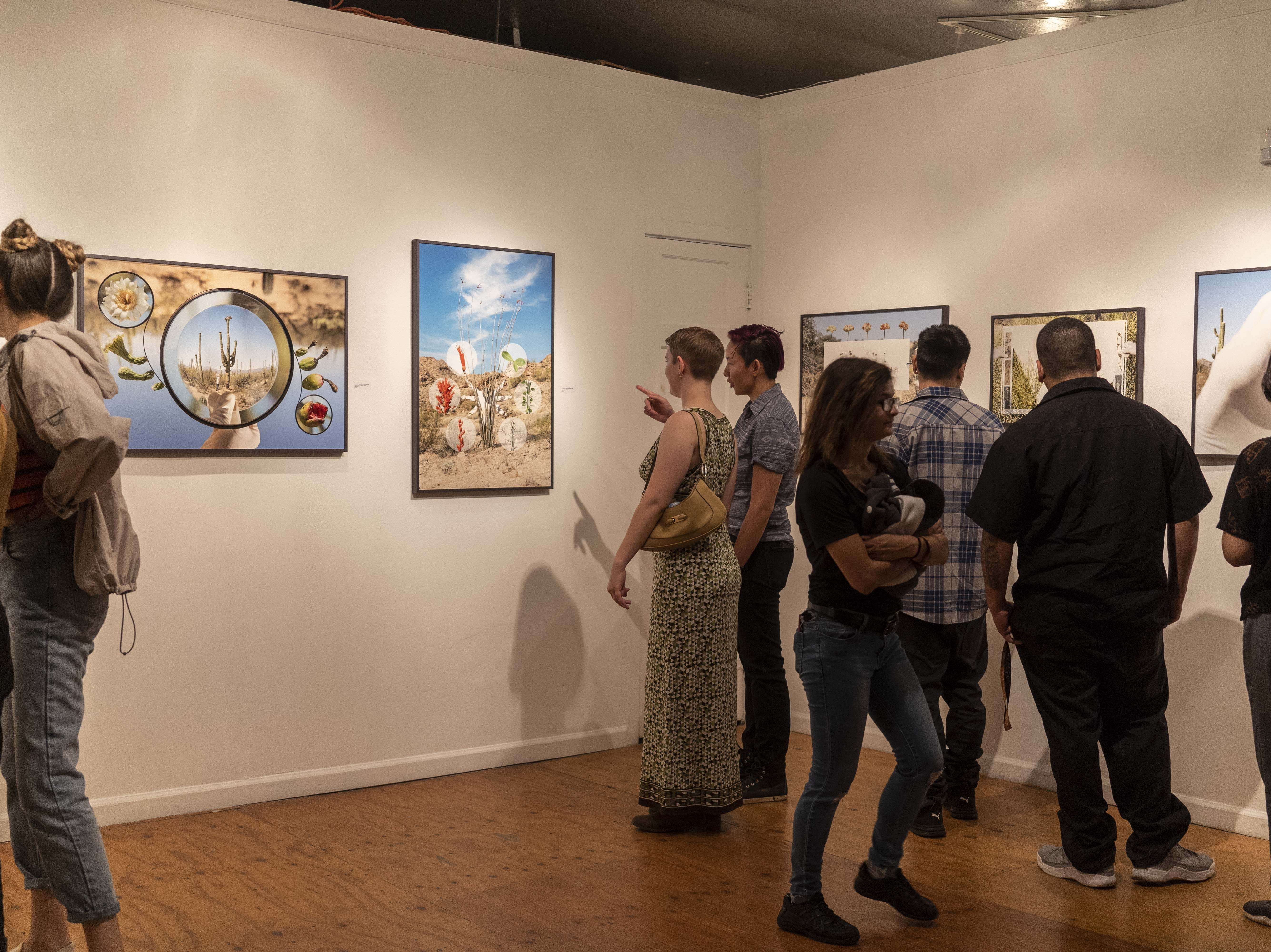 People enjoy artwork during the First Friday Art walk, on Roosevelt Street in Downtown Phoenix, on Oct. 5, 2018.