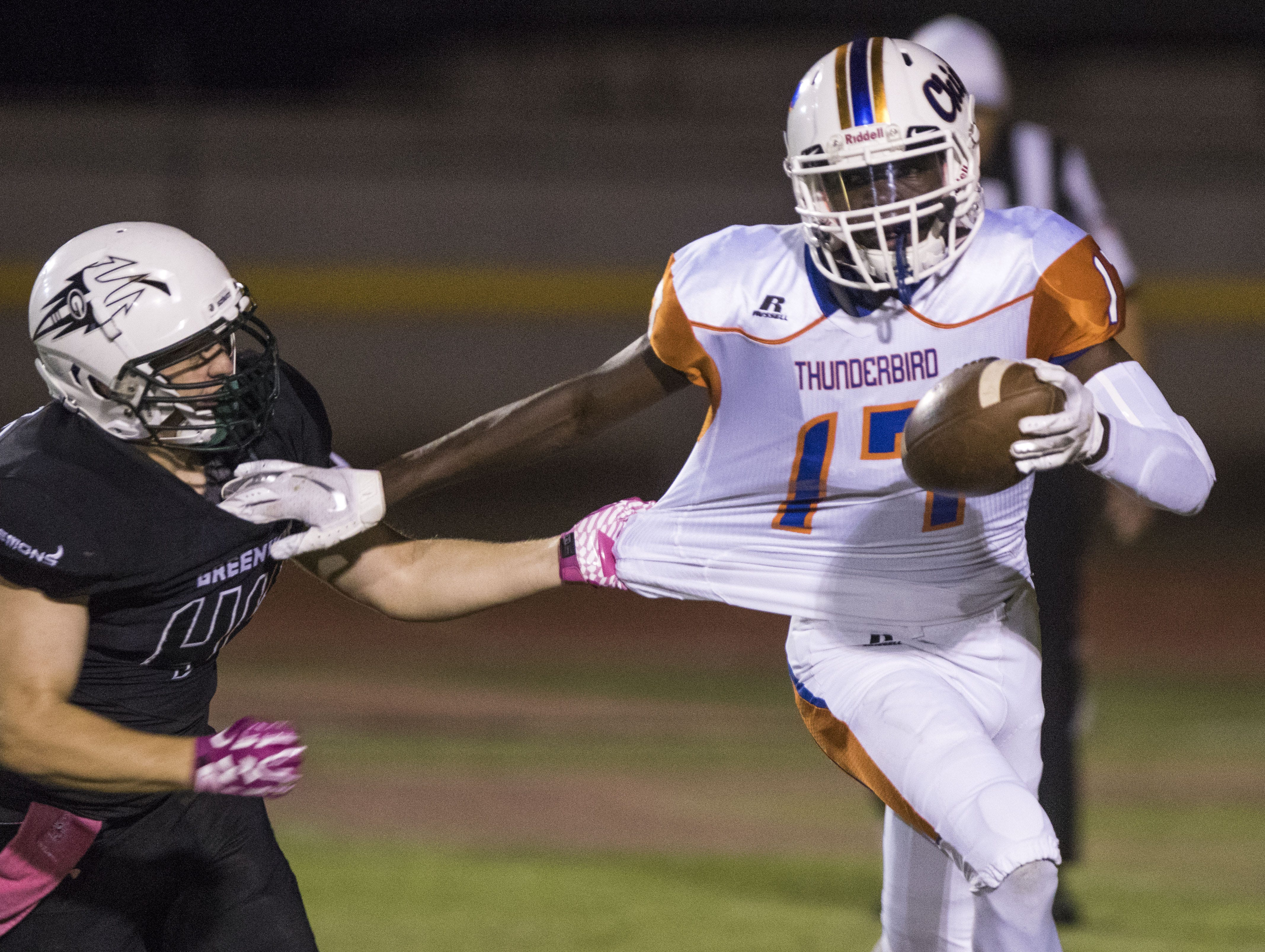 Thunderbird's Joel Goulbourne can't get away from Washington's Mathew Smith in Phoenix Friday, Oct. 5, 2018. #azhsfb