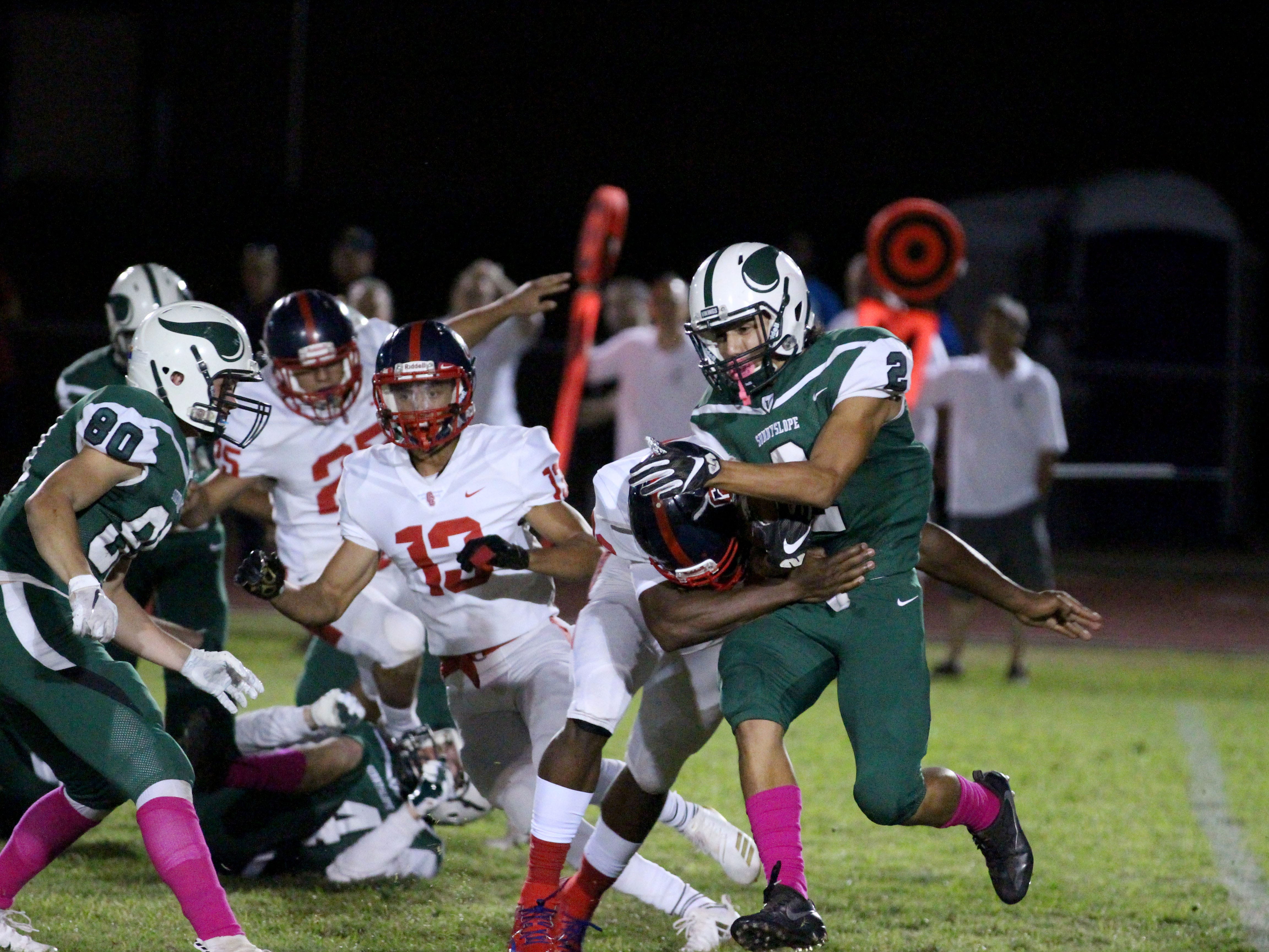 Sunnyslope's Eliah Rodriguez breaks a Centennial tackle on Friday night at Sunnyslope High School on Oct. 5, 2018
