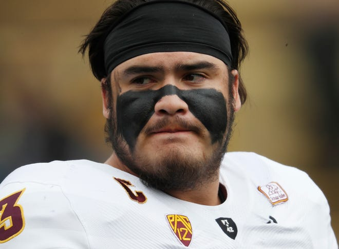 Arizona State offensive lineman Cohl Cabral warms up before an NCAA college football game against Colorado Saturday, Oct. 6, 2018, in Boulder, Colo. (AP Photo/David Zalubowski)