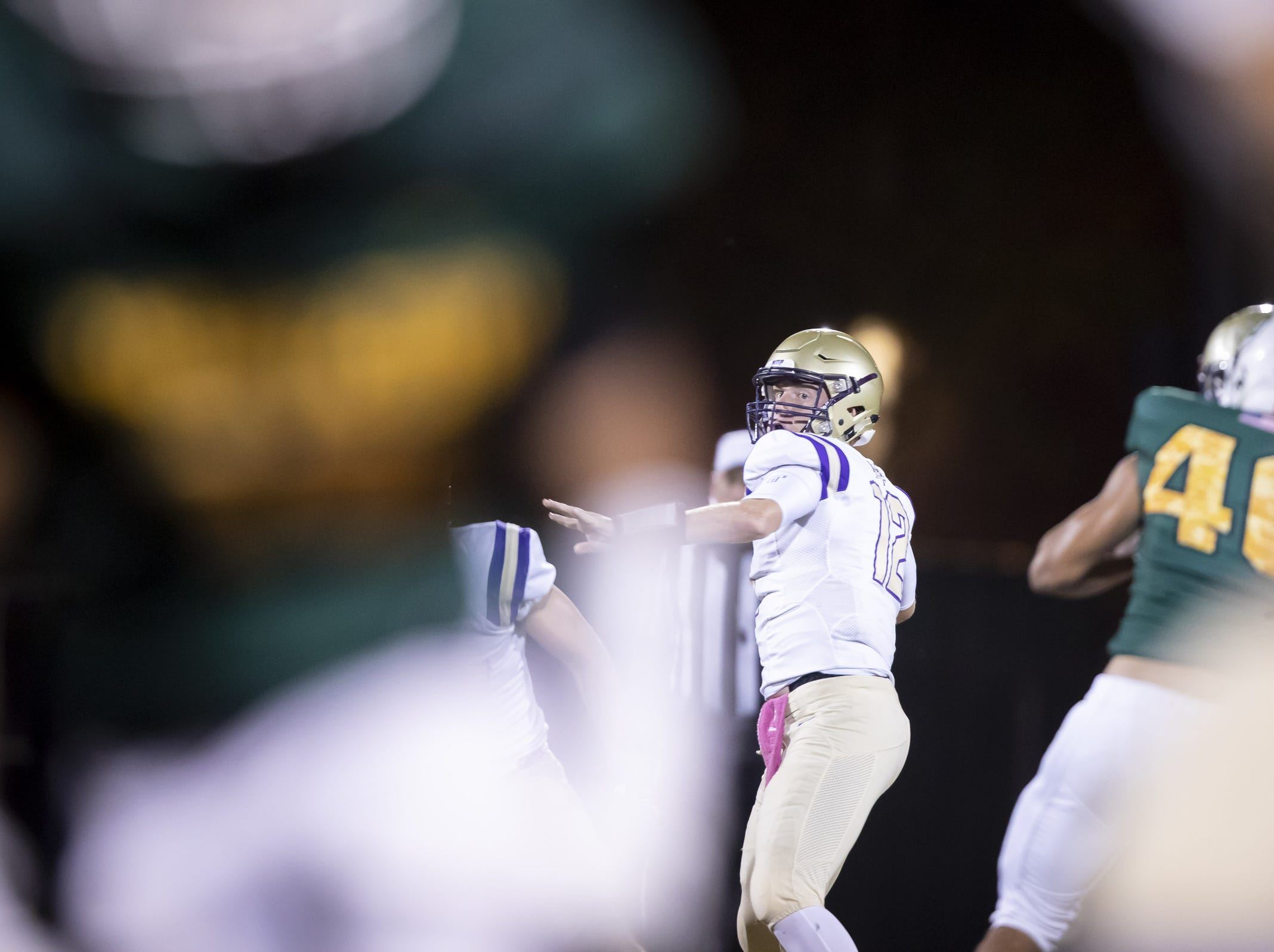 Senior quarterback Jake Farrell (12) of the Notre Dame Prep Saints looks to throw a pass against the Horizon Huskies at Horizon High School on Friday, October 5, 2018 in Scottsdale, Arizona. #azhsfb
