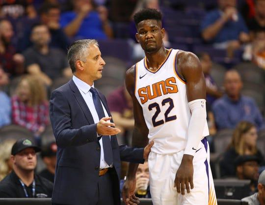 Phoenix Suns head coach Igor Kokoskov takls to center Deandre Ayton against the Portland Trail Blazers during a preseason game at Talking Stick Resort Arena on Oct. 5, 2018, in Phoenix, Ariz.