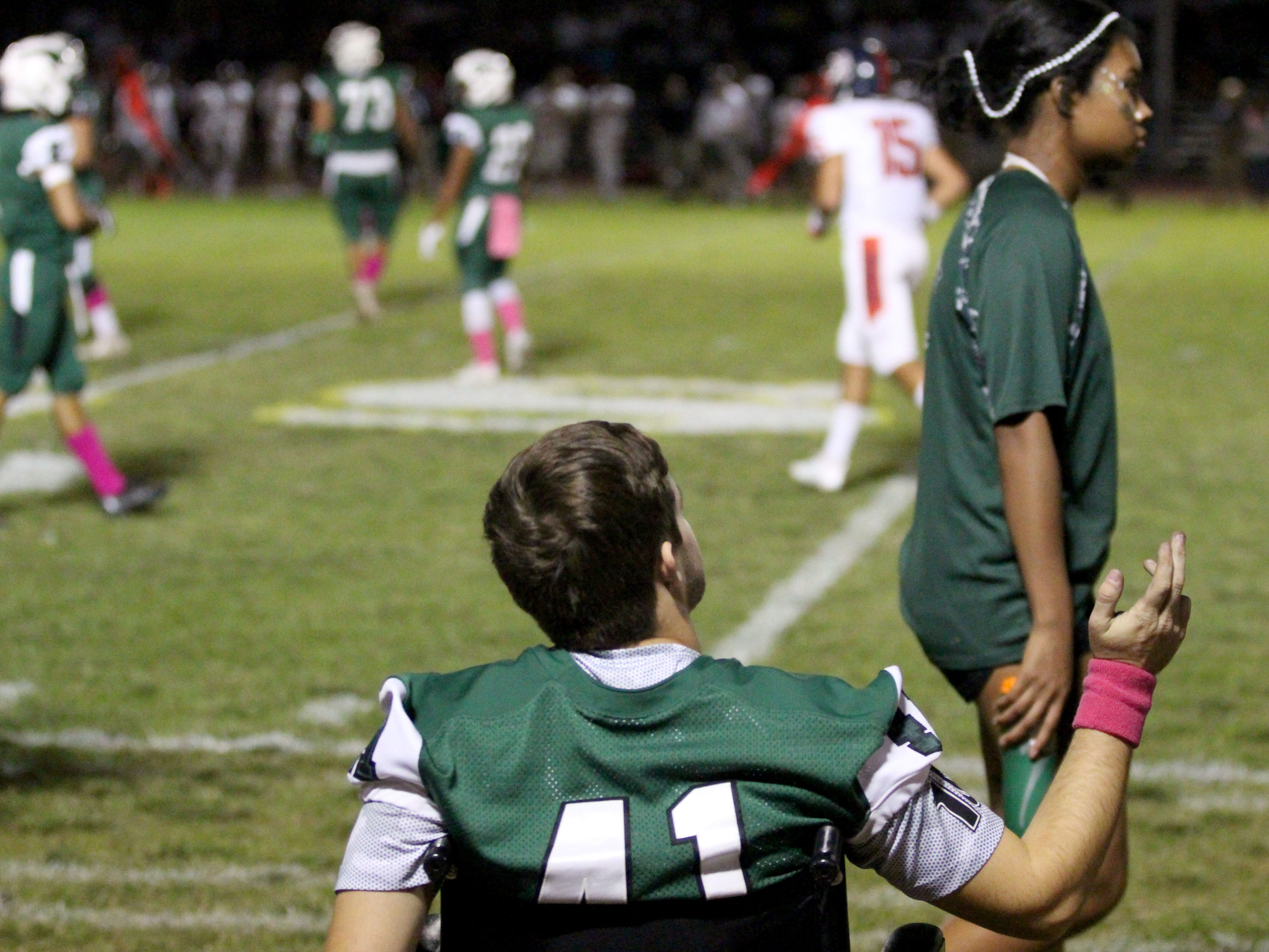 Injured Sunnyslope player Garrett Cooper watches the team from his wheelchair on the sideline on Friday night at Sunnyslope High School on Oct. 5, 2018