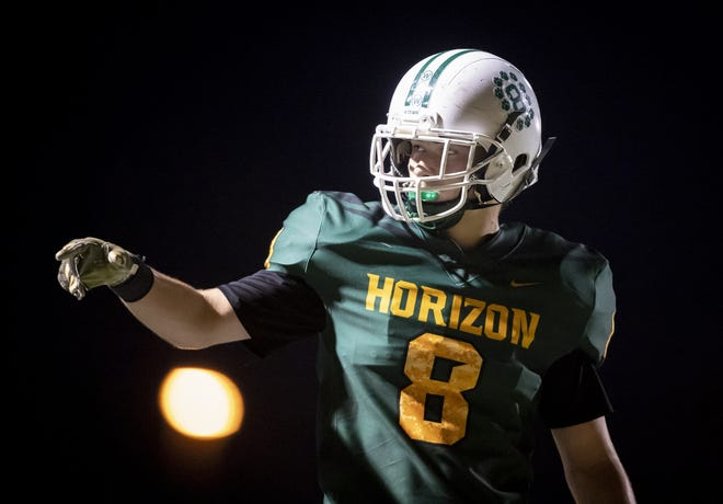 Junior outside linebacker Jay Rudolph (8) of the Horizon Huskies motions during the game against the Notre Dame Prep Saints  at Horizon High School on Friday, October 5, 2018 in Scottsdale, Arizona. #azhsfb