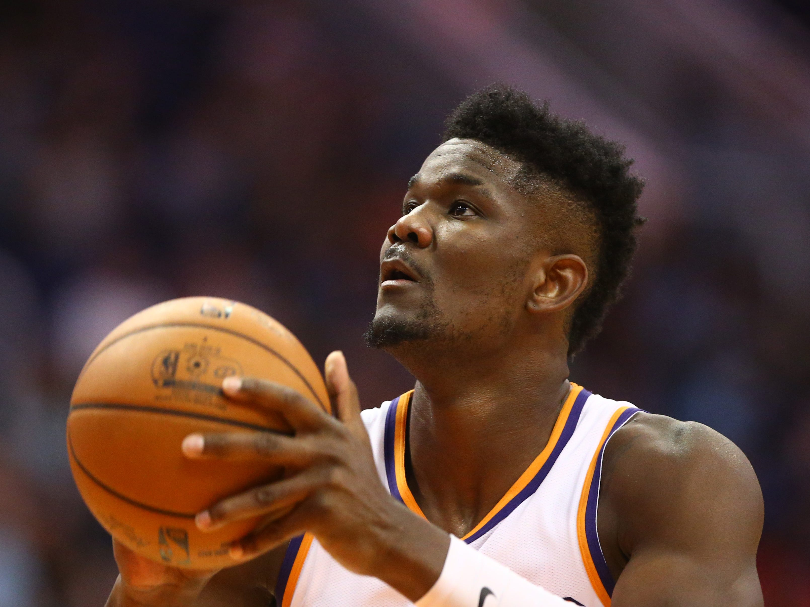 Phoenix Suns center Deandre Ayton shoots a free throw against the Portland Trail Blazers during a preseason game at Talking Stick Resort Arena on Oct. 5, 2018, in Phoenix, Ariz.
