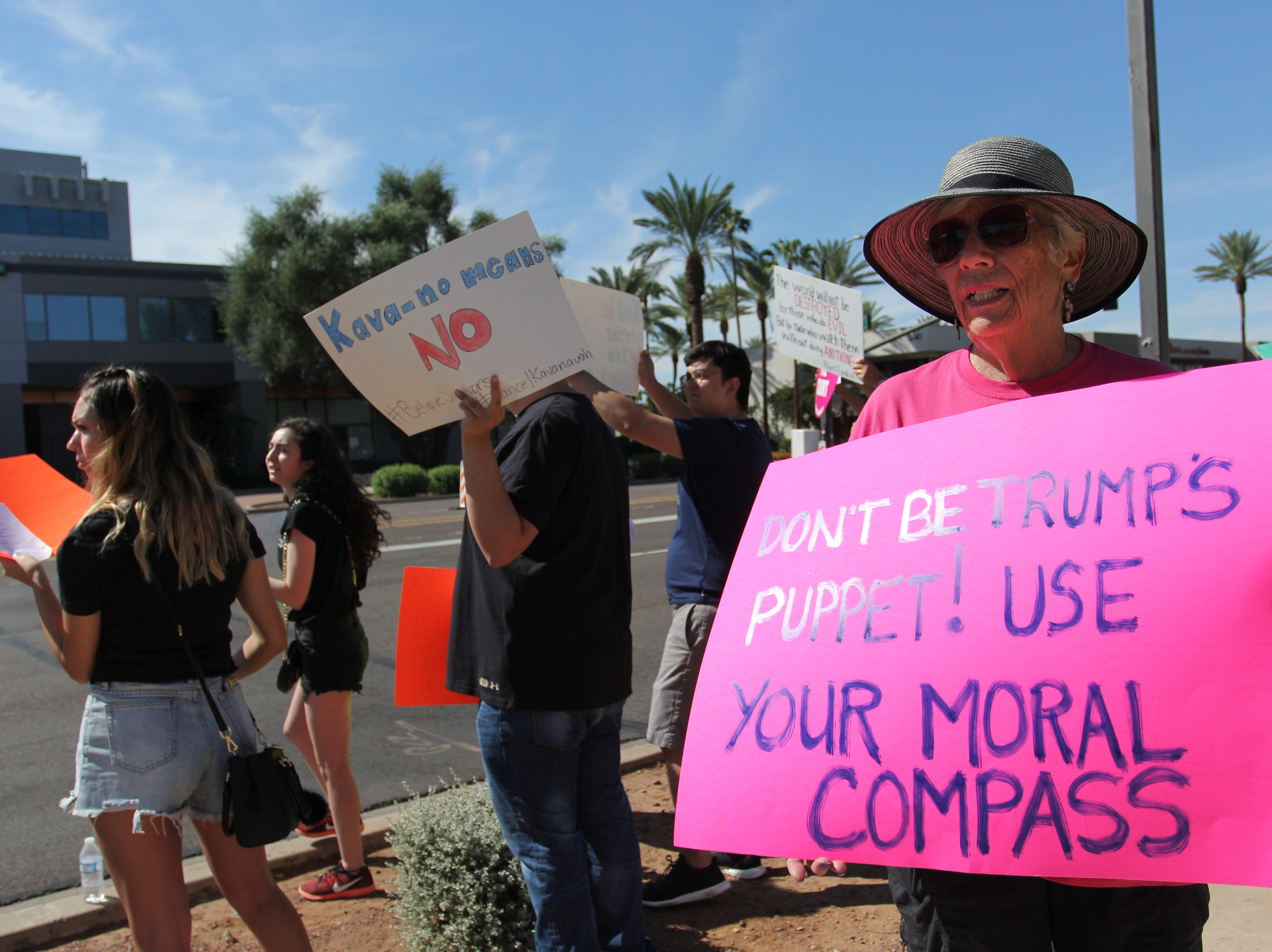 Protester rally outside Sen. Flake's Phoenix office on Saturday Nov. 6, 2018.