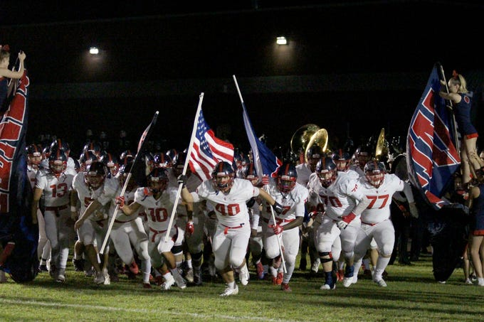 Centennial takes the field before its game against Sunnyslope on Friday night at Sunnyslope High School on Oct. 5, 2018