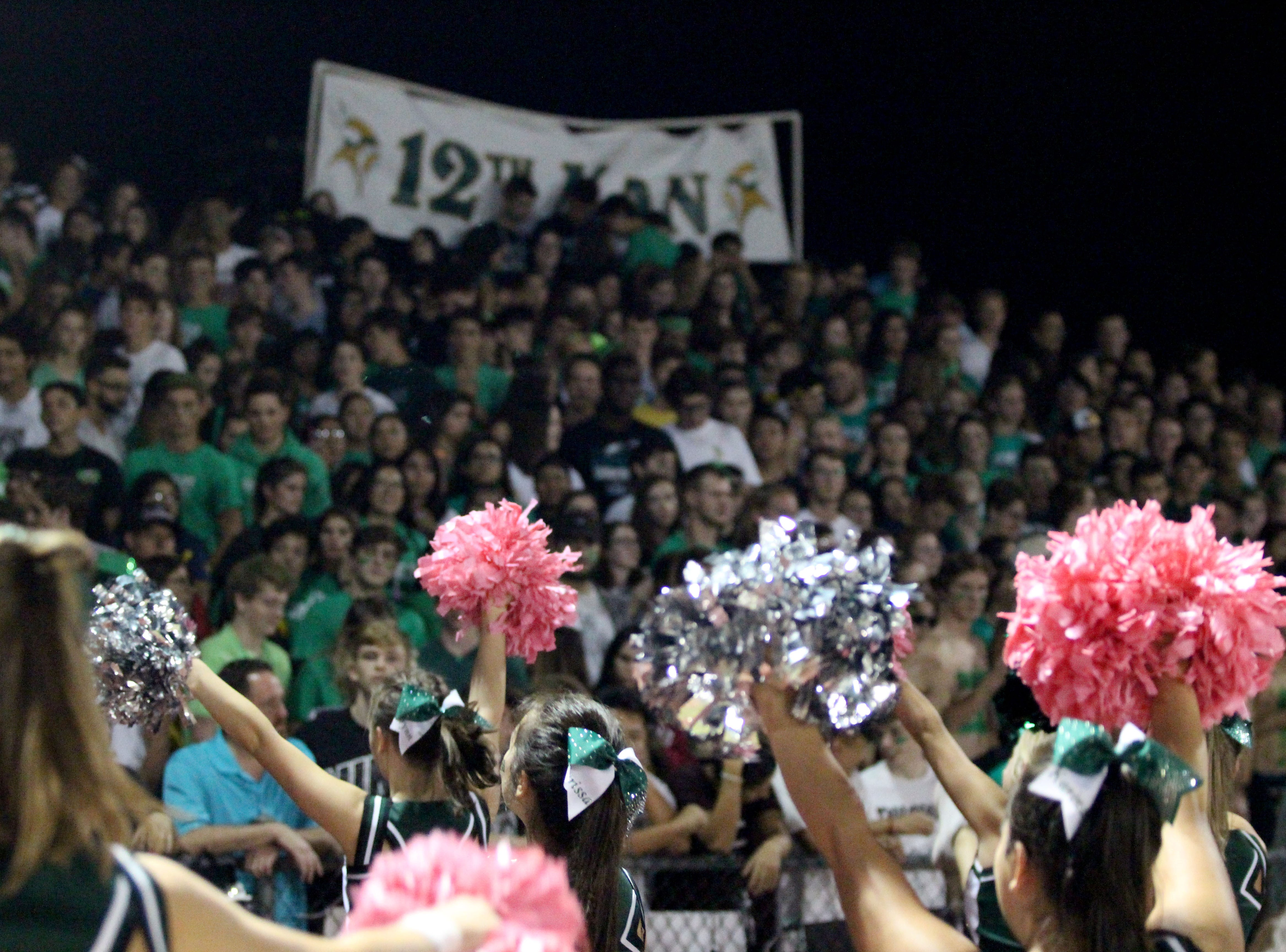 Sunnyslope cheerleaders try to pump up the crowd on Friday night at Sunnyslope High School on Oct. 5, 2018