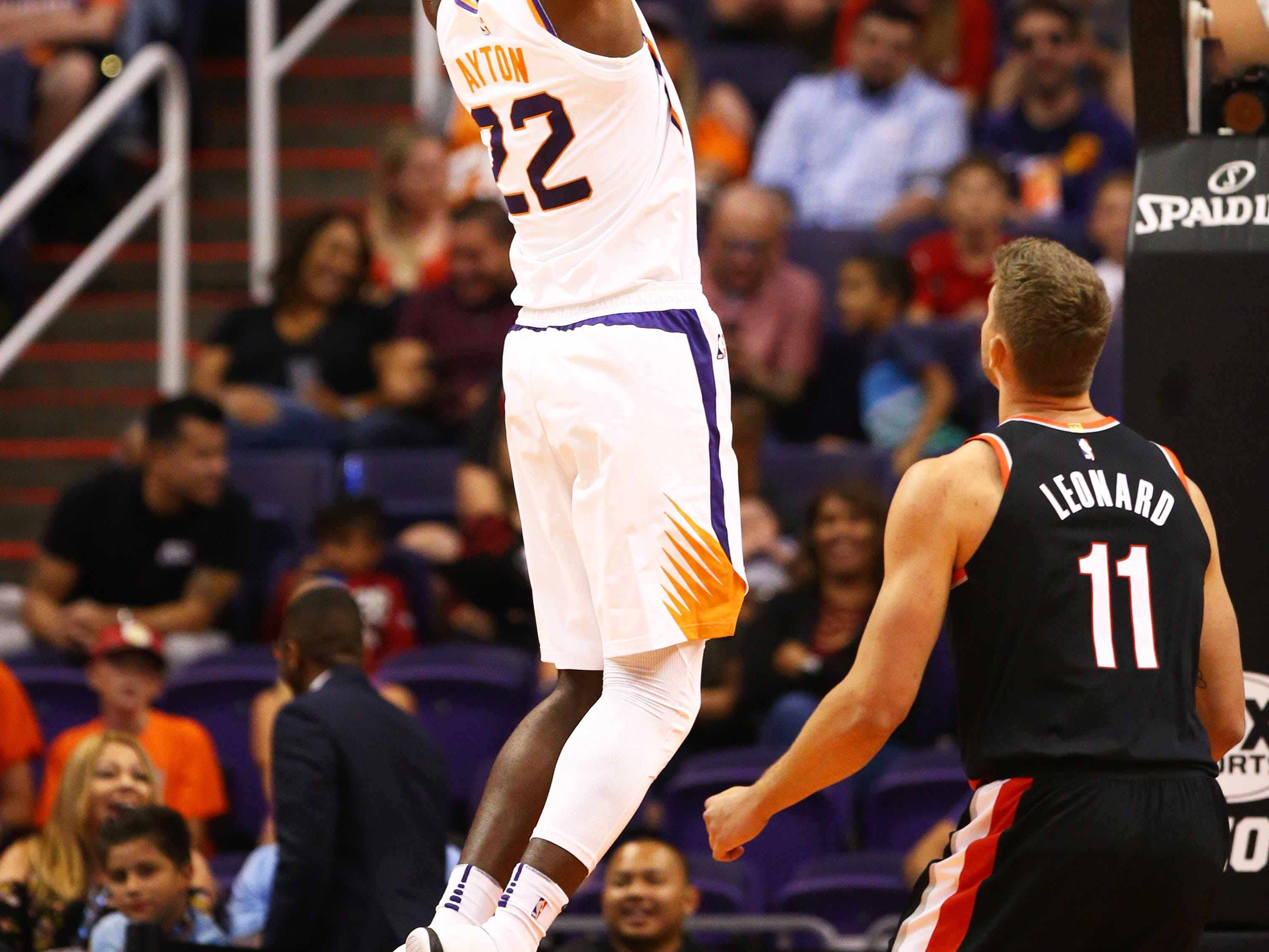 Phoenix Suns center Deandre Ayton dunks the ball against the Portland Trail Blazers during a preseason game at Talking Stick Resort Arena on Oct. 5, 2018, in Phoenix, Ariz.