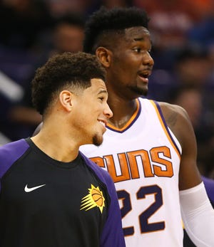 Phoenix Suns Devin Booker and Deandre Ayton against the Portland Trail Blazers during a preseason game at Talking Stick Resort Arena on Oct. 5, 2018, in Phoenix, Ariz.