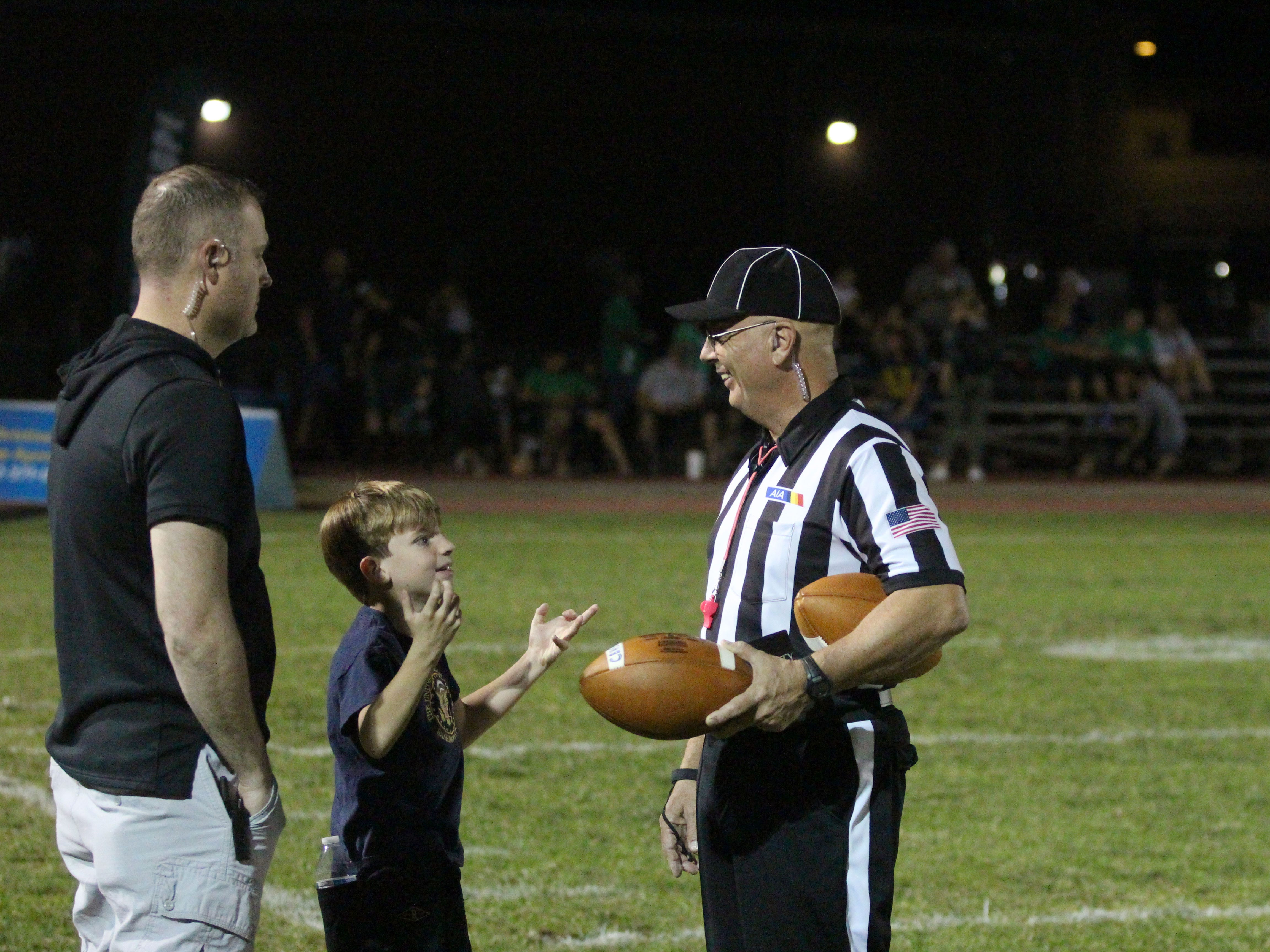 A kid talks to a referee before the Centennial vs Sunnyslope game on Friday night at Sunnyslope High School on Oct. 5, 2018