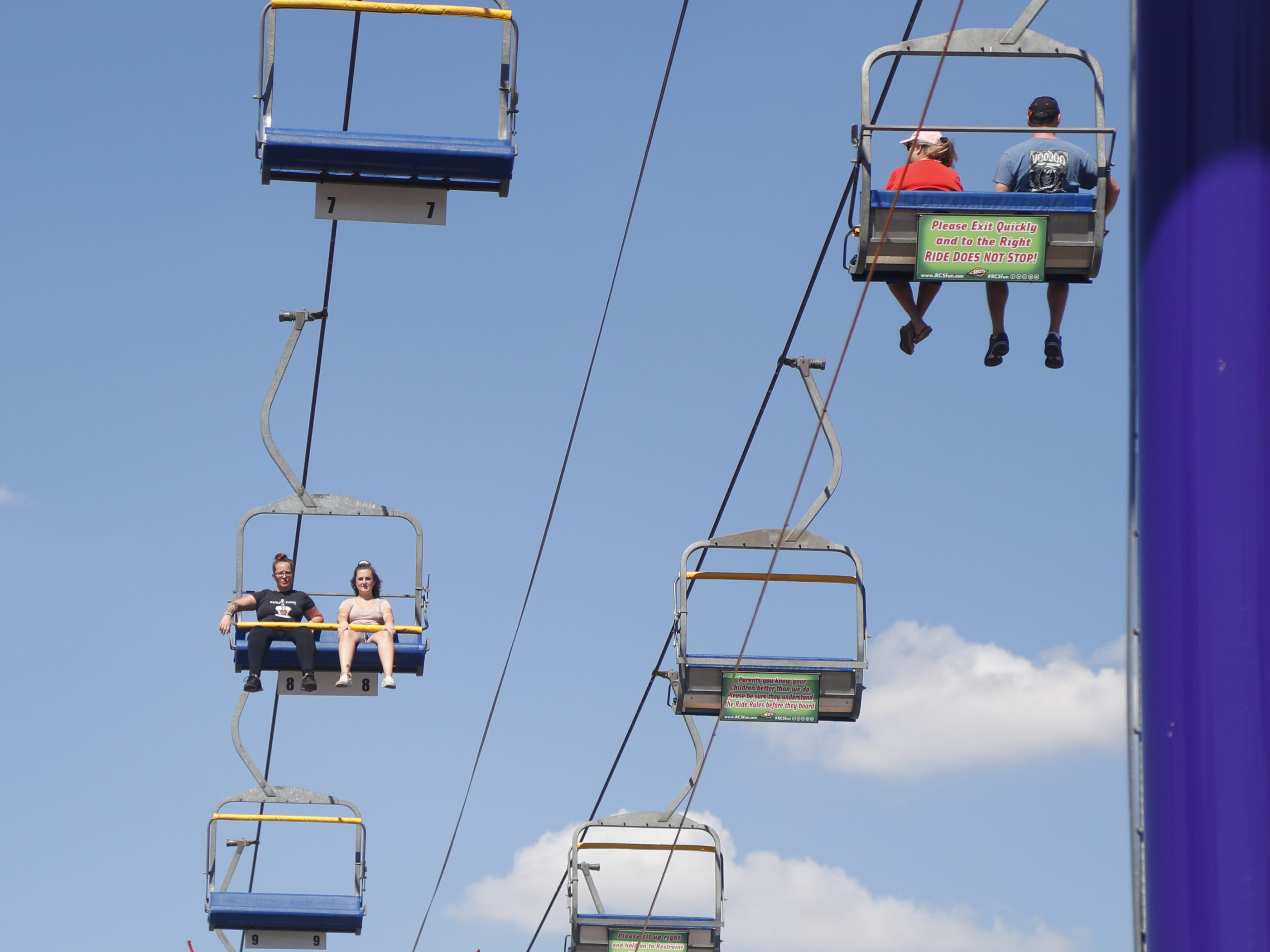 People ride the ski-lift at the Arizona State Fair in Tempe, Ariz. on October 5, 2018.
