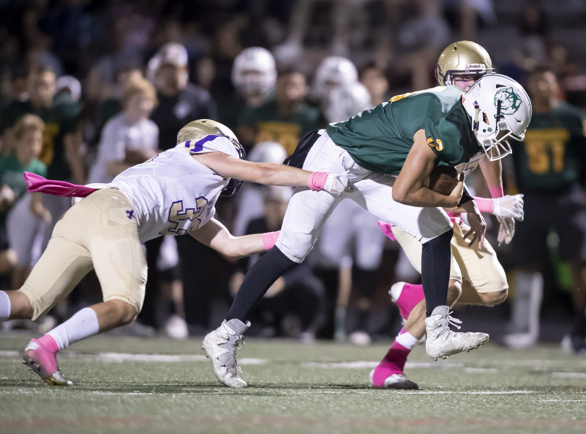 Senior quarterback Isaac Enriquez (3) of the Horizon Huskies runs the ball against junior cornerback Trey Cartledge (33) of the Notre Dame Prep Saints at Horizon High School on Friday, October 5, 2018 in Scottsdale, Arizona. #azhsfb