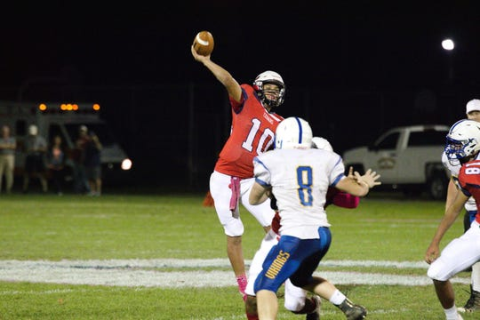 Lebanon QB Isaiah Rodriguez gets off a pass before Northern Lebanon defender Ethan Herb (8) can get to him.
