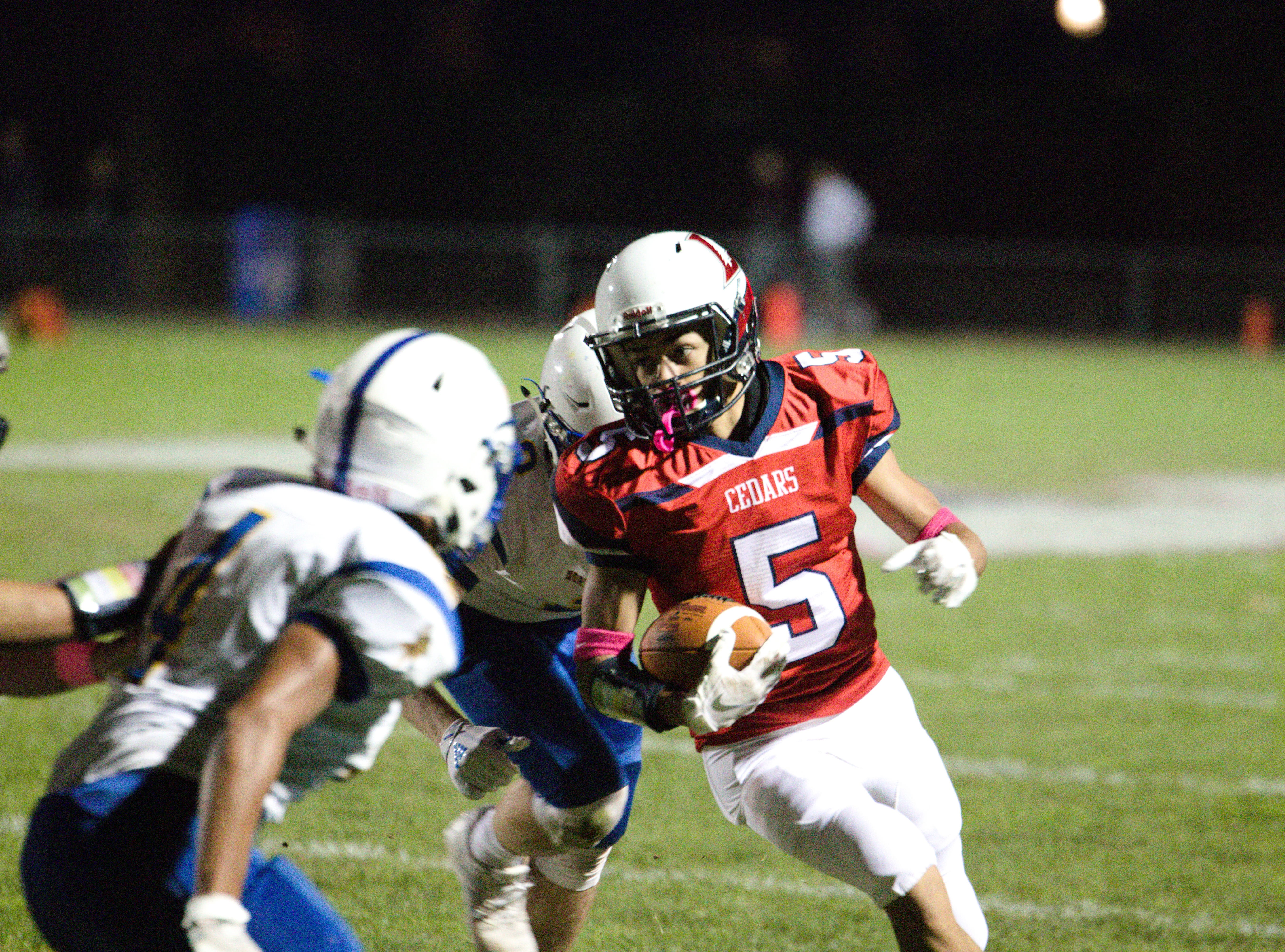 Lebanon's Alexander Rufe heads up the field after catching a pass