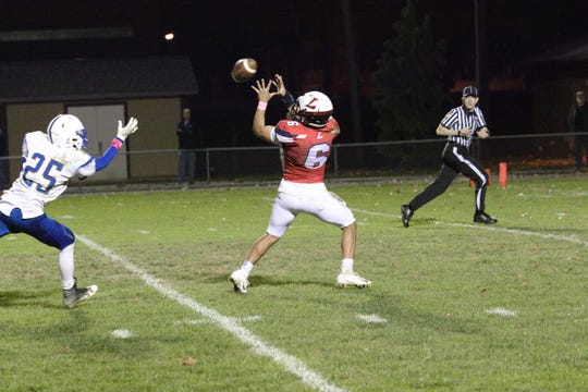Lebanon's Leighton Rivera hauls in a 35-yard TD pass from Isaiah Rodriguez that helped the Cedars to a 56-18 win vs. Northern Lebanon on Friday night.