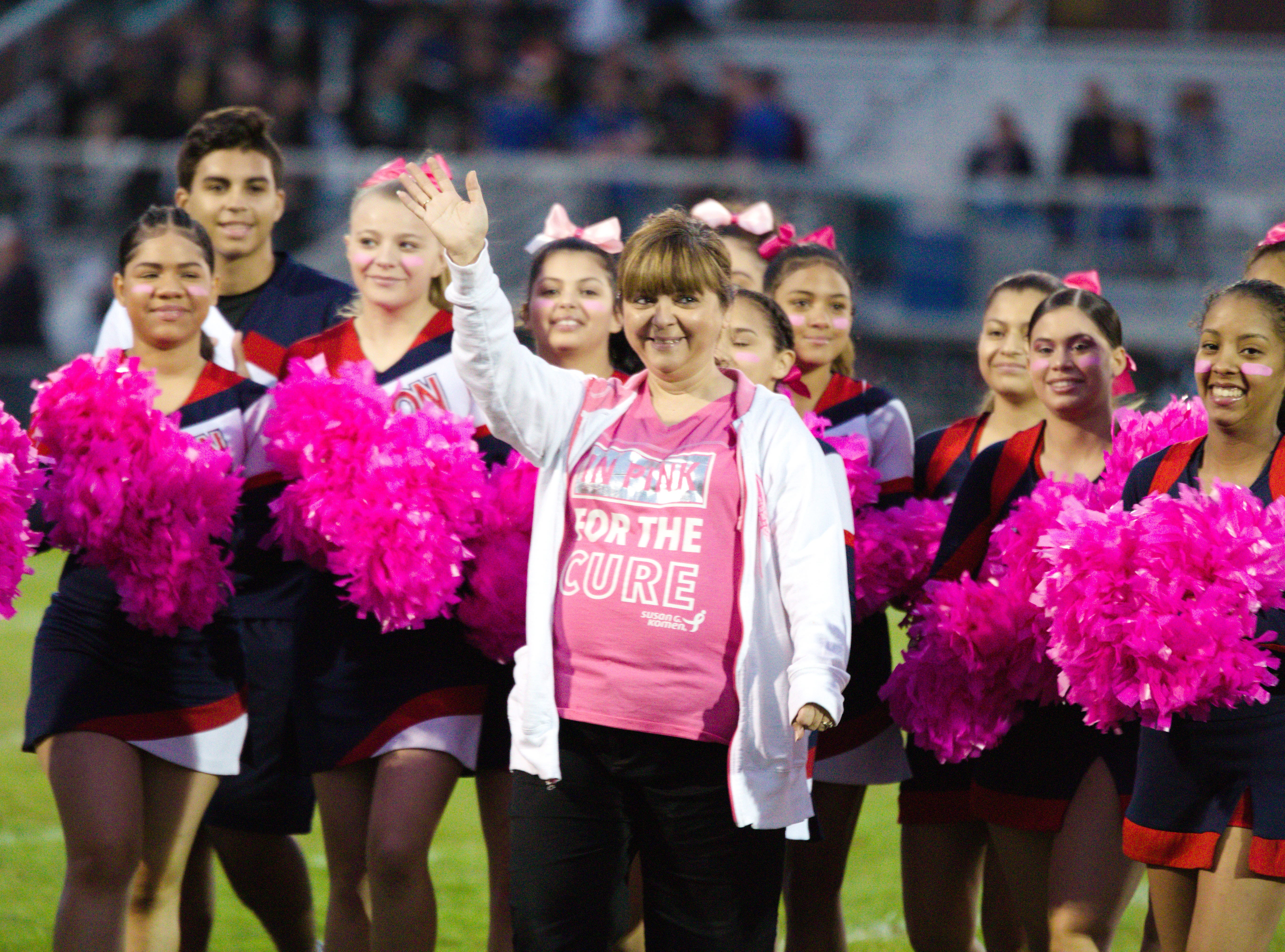 Lebanon cheerleaders brought awareness to the fight against breast cancer on Friday night.