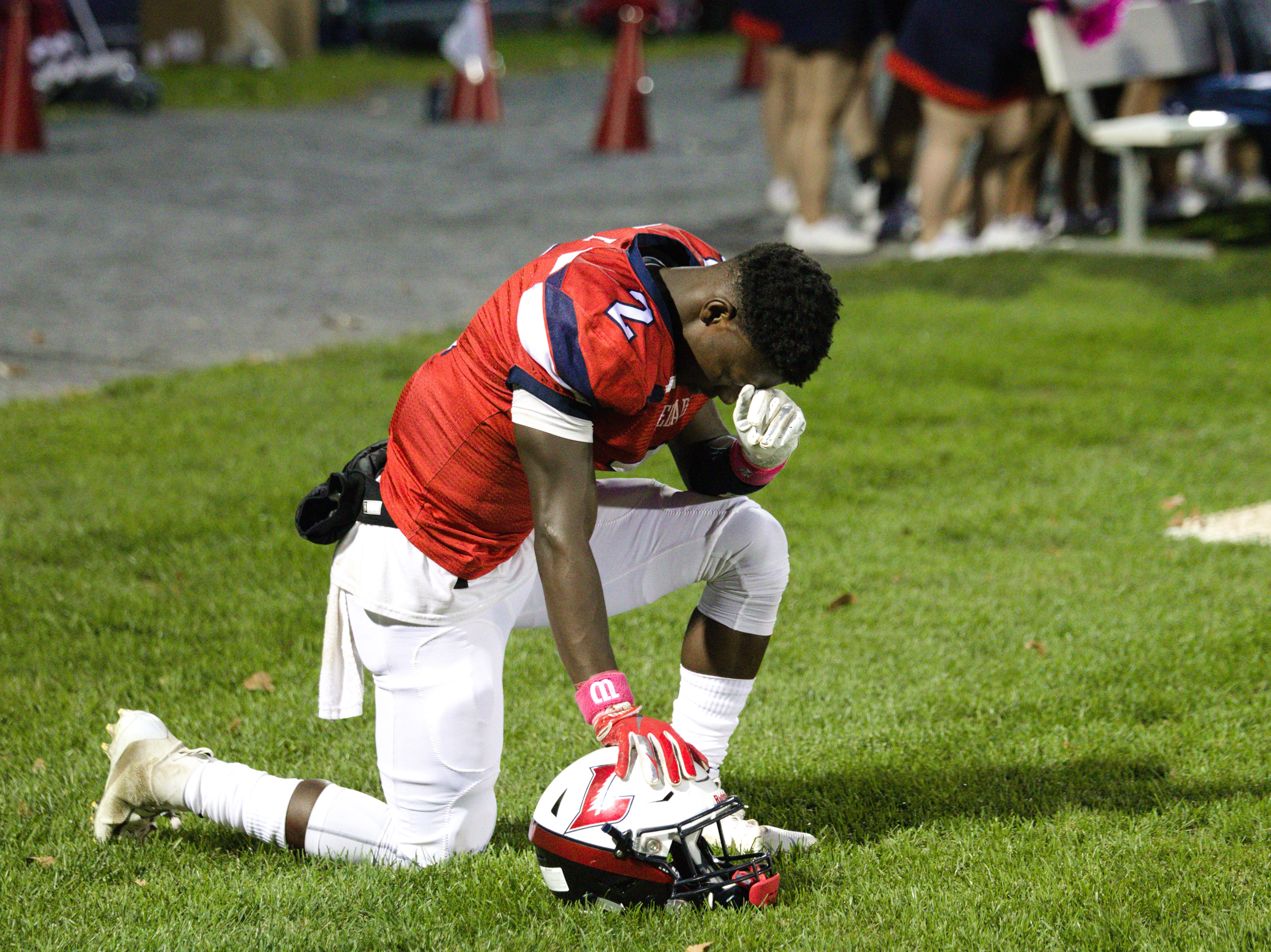 Lebanon's Jahlil Young takes a break from the action and composes himself.