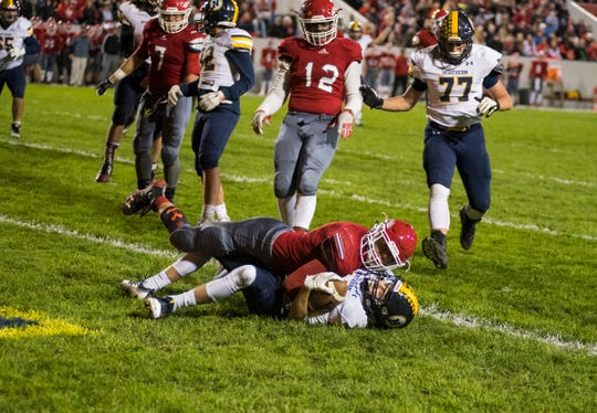 Port Huron Northern High School quarterback Seth Klink is tackled into the end zone by Port Huron High School defensive back Ryan Gilbert, giving Northern its first touchdown of the Crosstown Showdown Friday, Oct. 5, 2018 at Memorial Stadium.