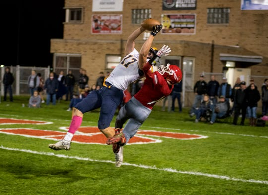Port Huron Northern's Braiden McGregor (17) catches a pass over Port Huron High School defensive back Ryan Gilbert on Oct. 5, 2018, at Memorial Stadium.