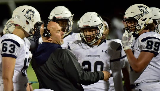 Trojans coach Mark Luther talks to players during a time out. Chambersburg Trojans jumped ahead of Central Dauphin East to win 26-20 in PIAA football on Friday, October 5, 2018.