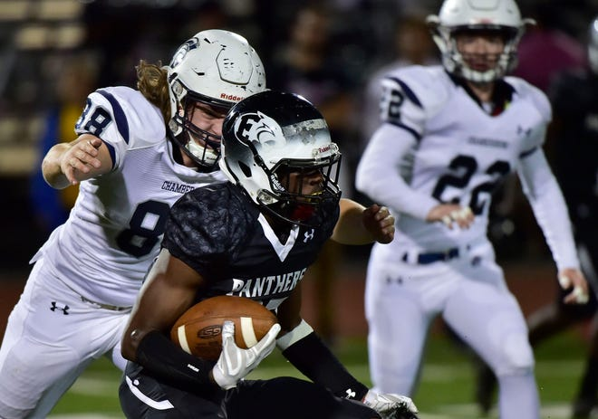 Central Dauphin East's Emmanuel Niang runs the ball for the Panthers and is chased by Garner Funk (88) of Chambersburg. Chambersburg Trojans jumped ahead of Central Dauphin East to win 26-20 in PIAA football on Friday, October 5, 2018.
