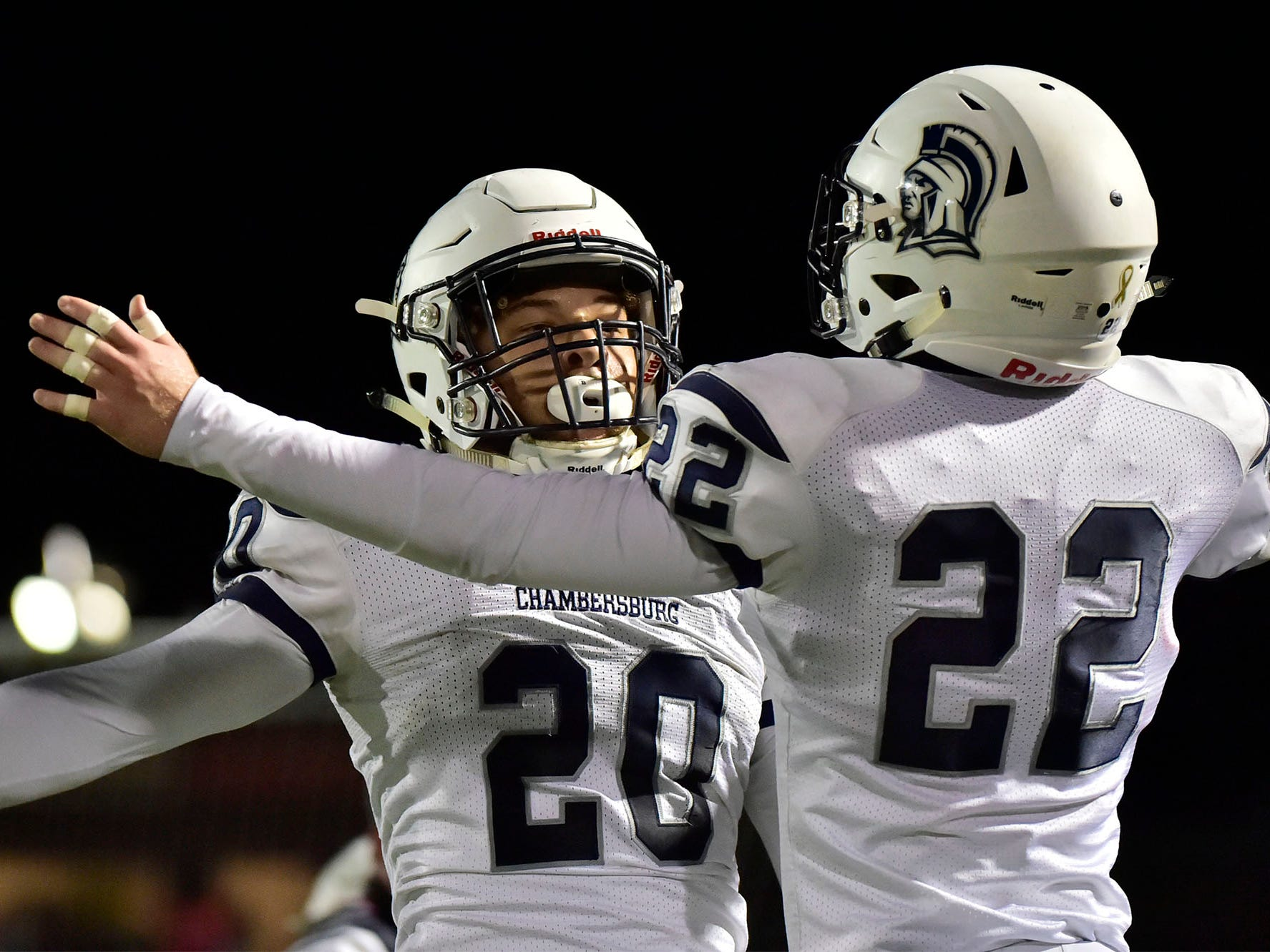 Chambersburg Kyere Morton (20) celebrates his TD with teammate Tucker Perry (22). Chambersburg Trojans jumped ahead of Central Dauphin East to win 26-20 in PIAA football on Friday, October 5, 2018.