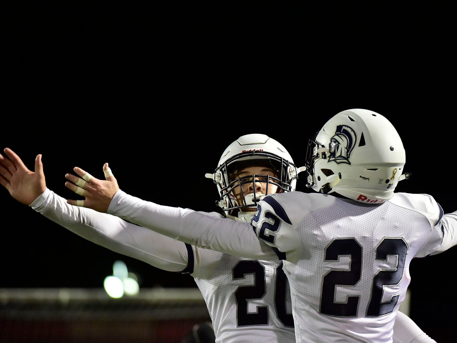 Kyere Morton (2) of Chambersburg celebrates a touchdown with teammate Tucker Perry (22). Chambersburg Trojans jumped ahead of Central Dauphin East to win 26-20 in PIAA football on Friday, October 5, 2018.