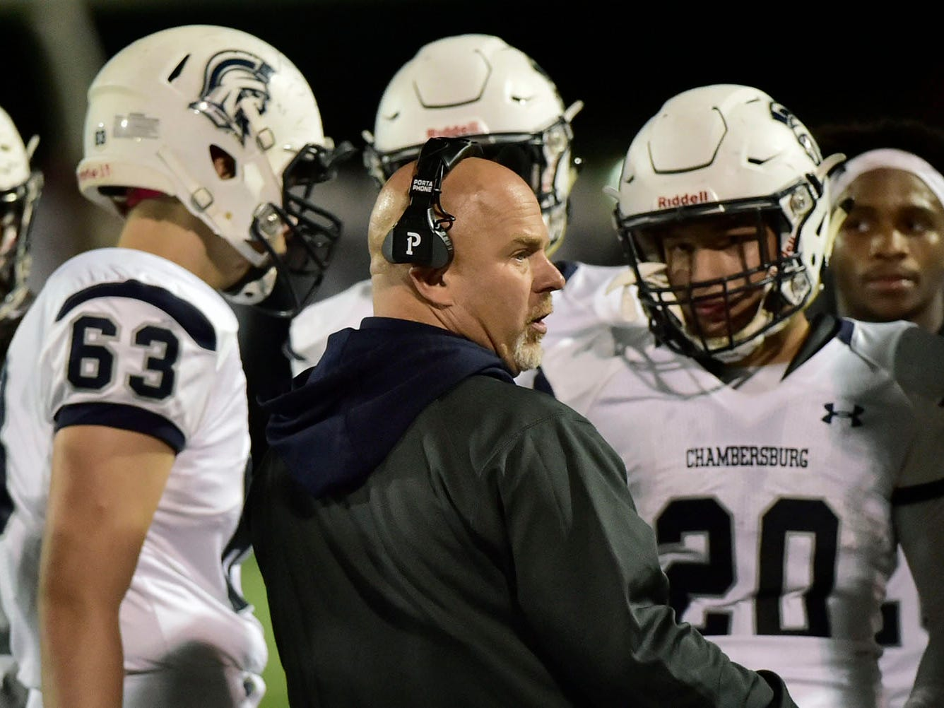 Chambersburg coach Mark Luther talks to players during a time out. Chambersburg Trojans jumped ahead of Central Dauphin East to win 26-20 in PIAA football on Friday, October 5, 2018.