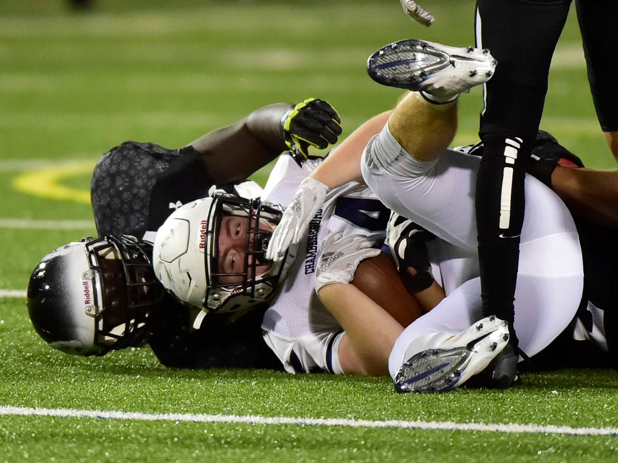 Chambersburg's Andrew Shetter (24) is tackled after a gain for the Trojans. Chambersburg Trojans jumped ahead of Central Dauphin East to win 26-20 in PIAA football on Friday, October 5, 2018.