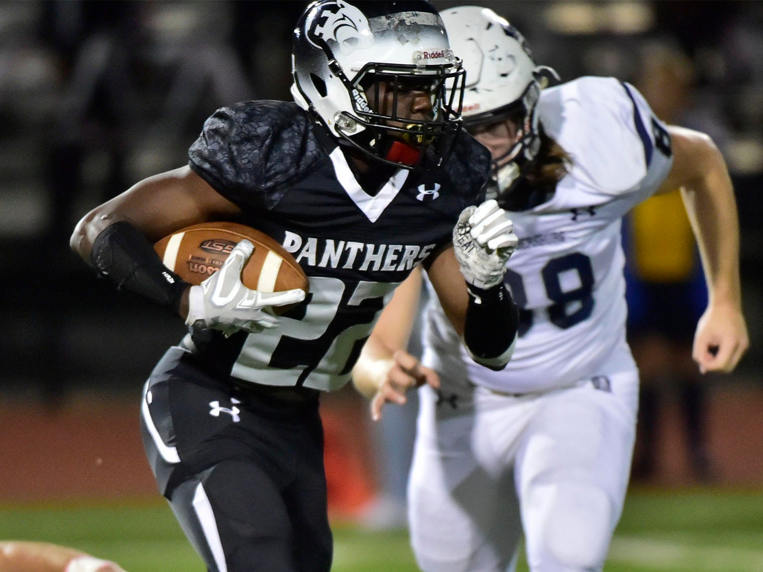 Central Dauphin East's Emmanuel Niang runs the ball for the Panthers as Chambersburg's Garner Funk gives chase. Chambersburg Trojans jumped ahead of Central Dauphin East to win 26-20 in PIAA football on Friday, October 5, 2018.