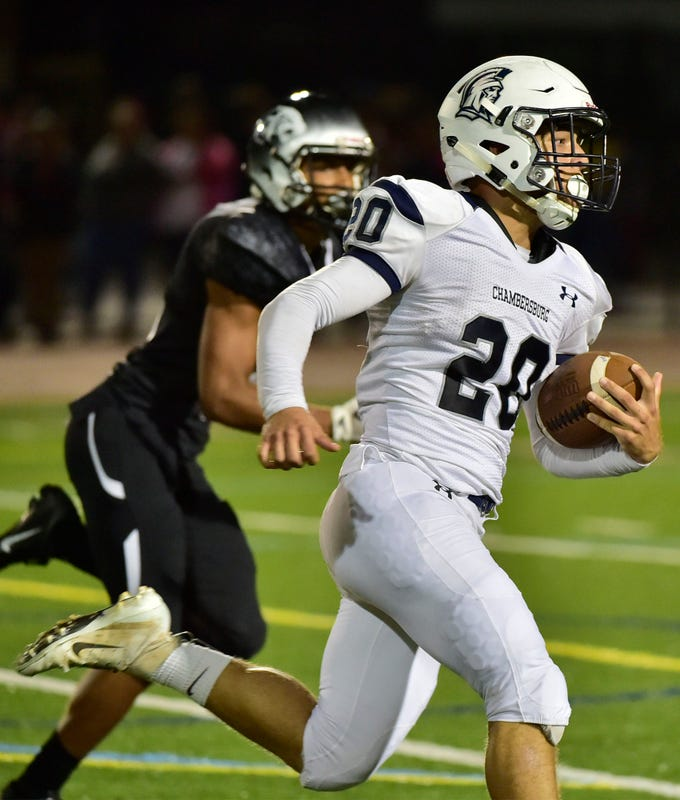 Chambersburg's Kyere Morton runs the ball past a CD East defender for a Trojan first half score. Chambersburg Trojans defeated  Central Dauphin East 26-20 in PIAA football on Friday, October 5, 2018.