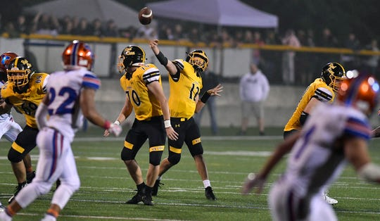 Red Lion's Zach Mentzer, shown here throwing a pass earlier this season, threw for four touchdowns and ran for another in the Lions' victory last week. DISPATCH FILE PHOTO