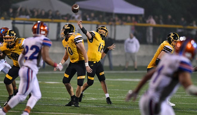 Red Lion quarterback Zach Mentzer guns a pass to wide-out Randy Fizer Jr. for the game-tying touchdown against York High, Friday, Oct. 5, 2018. A good extra point attempt gave the Lions a 21-20 win over the Bearcats. John A. Pavoncello