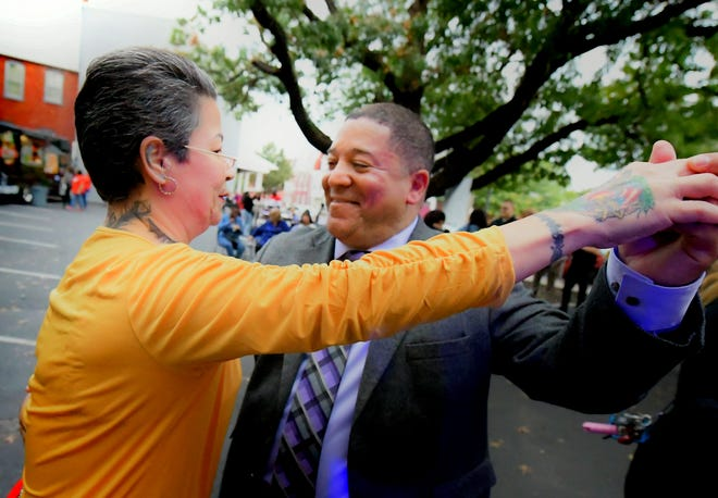 Lou Rivera, chairman of the local Latino advocacy nonprofit Latinos Unidos, dances with Mary Cabrera of York City during First Friday Latinos outside CASA's York City welcoming center Friday, Oct. 5, 2018. Rivera announced his candidacy for York City Council during the event. Bill Kalina photo