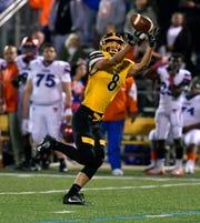 Ben Hornberger catches a pass from quaterback Zach Mentzer for a Red Lion touchdown against York High, Friday, Oct. 5, 2018 John A. Pavoncello