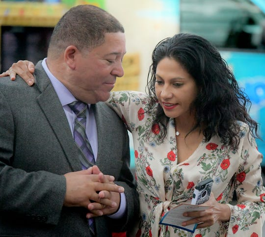 Lou Rivera, chairman of the local Latino advocacy nonprofit Latinos Unidos, talks with Patricia Zapata of York City during First Friday Latinos outside CASA's York City welcoming center Friday, Oct. 5, 2018. Rivera announced his candidacy for York City Council during the event. Bill Kalina photo
