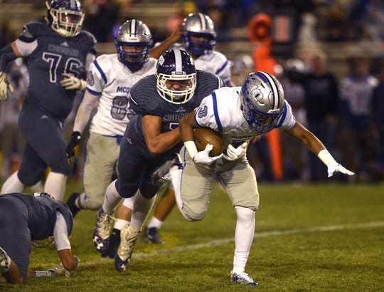 McQueen's JD Kolb (3) looks to run while taking on Spanish Springs during their football game in Reno on Oct. 5.