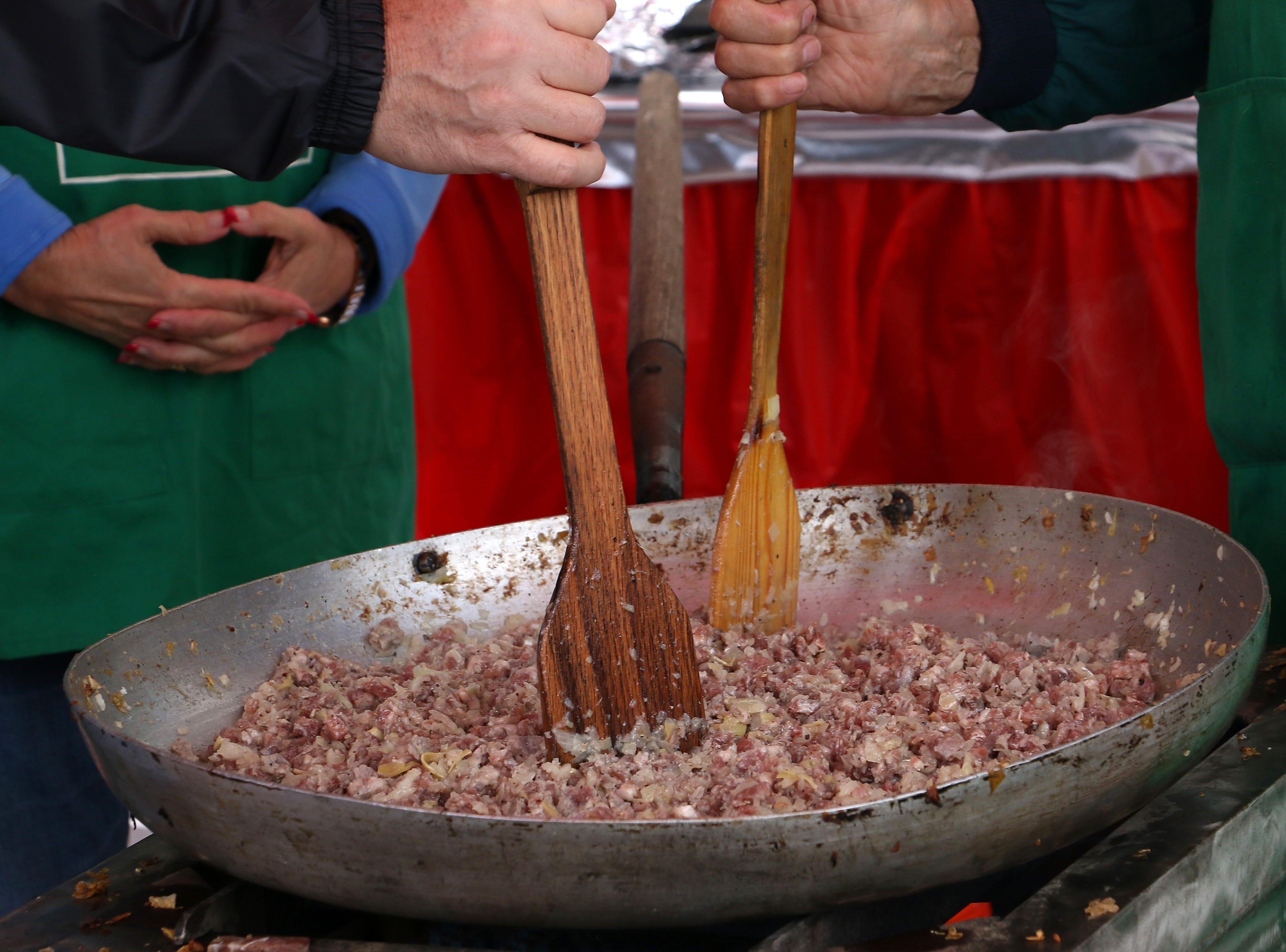 Chefs prepare an artichoke dish during the Eldorado Great Italian Festival in downtown Reno on Oct. 6, 2018.