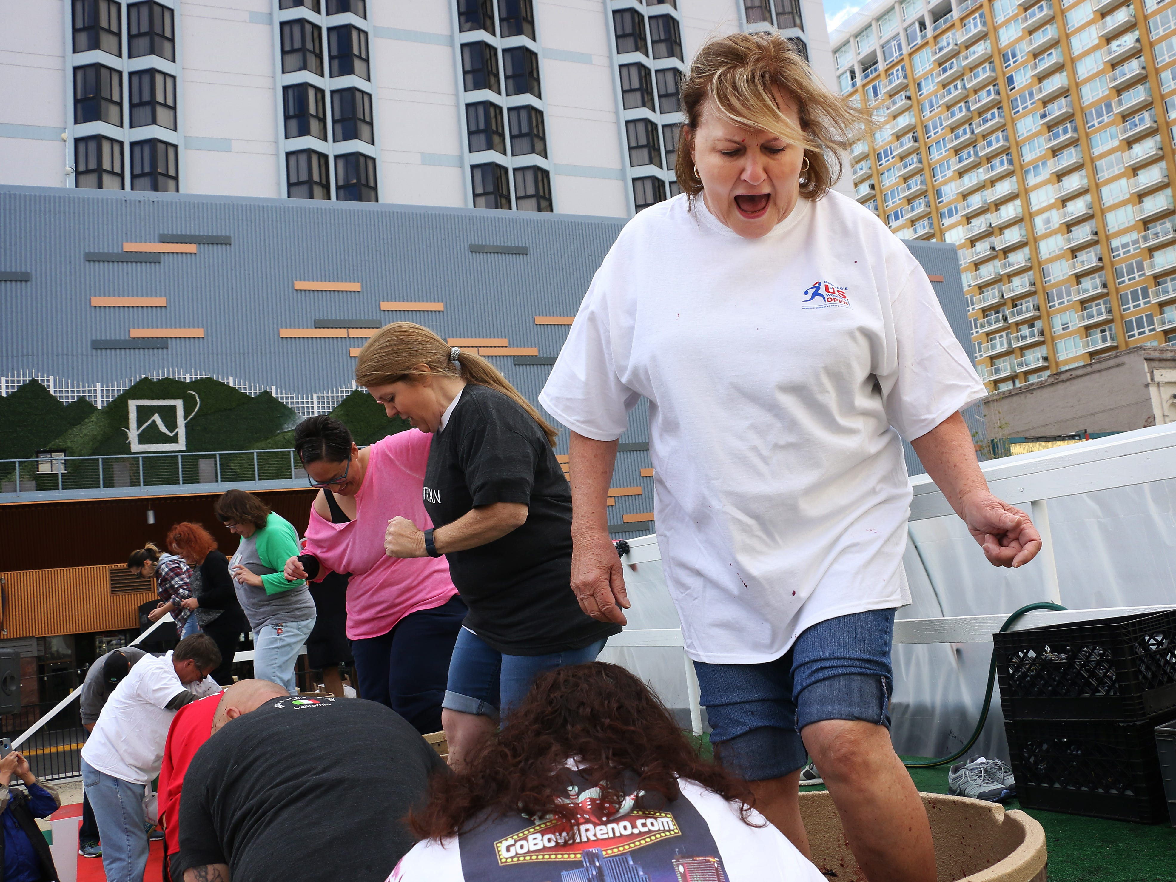 Kathi Lepore, right, participates in the grape stomping competition during the Eldorado Great Italian Festival in downtown Reno on Oct. 6, 2018.