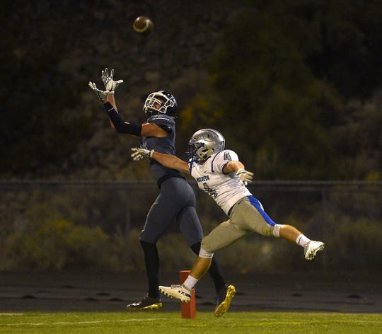 Spanish Springs' Jordan Dudick (11) makes a catch while taking on McQueen during their football game in Reno on Oct. 5, 2018.