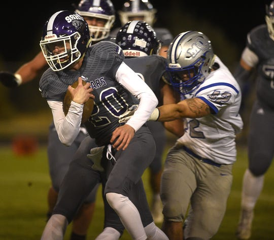Spanish Springs' Tristan Szabo (20) looks to run while taking on McQueen during their football game in Reno on Oct. 5, 2018.