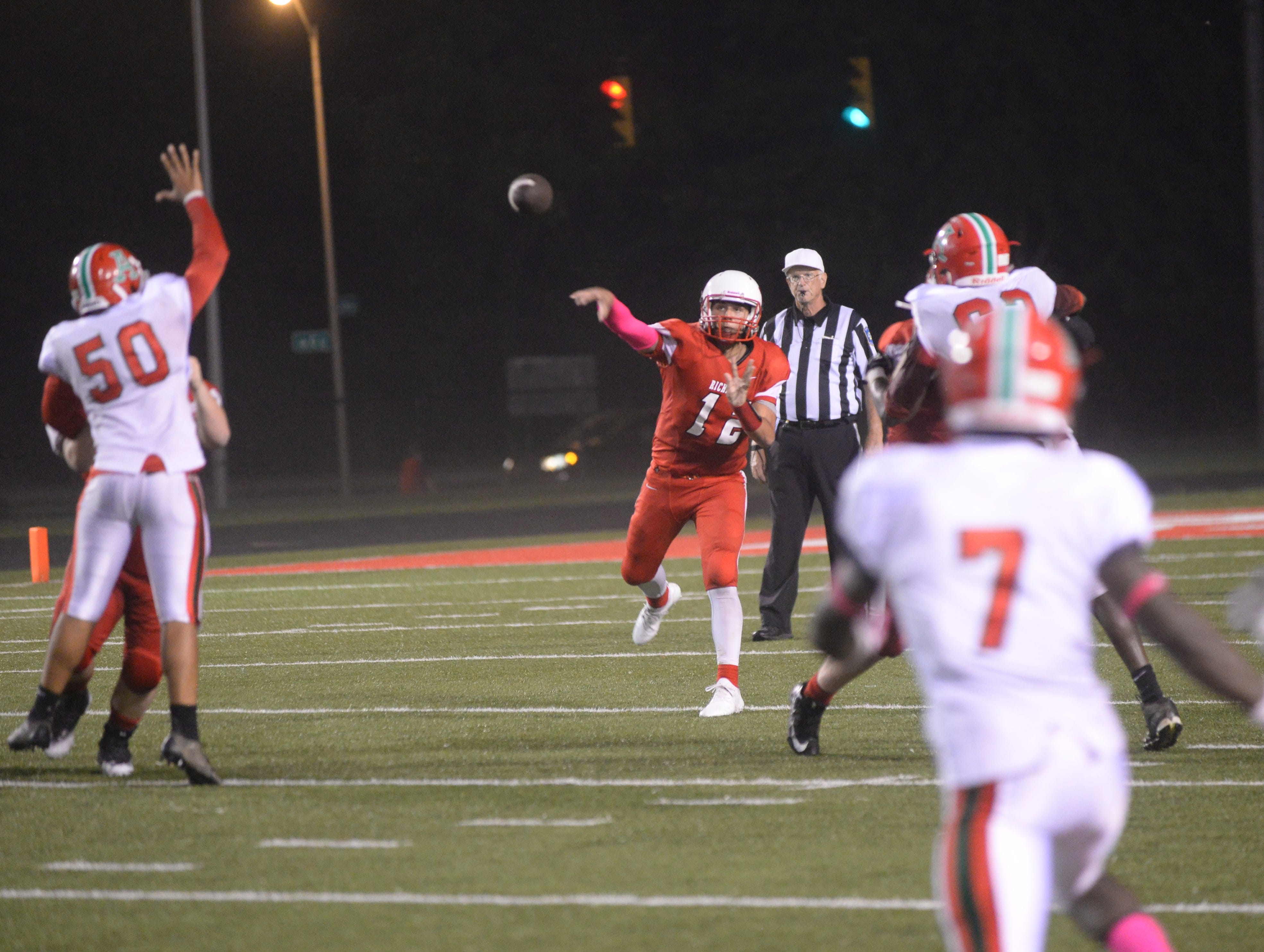 Richmond's Zach Hill (12) throws pass during the Richmond High School football team's  27-26 loss to Anderson Friday, Oct. 5, 2018 at Lyboult Field.
