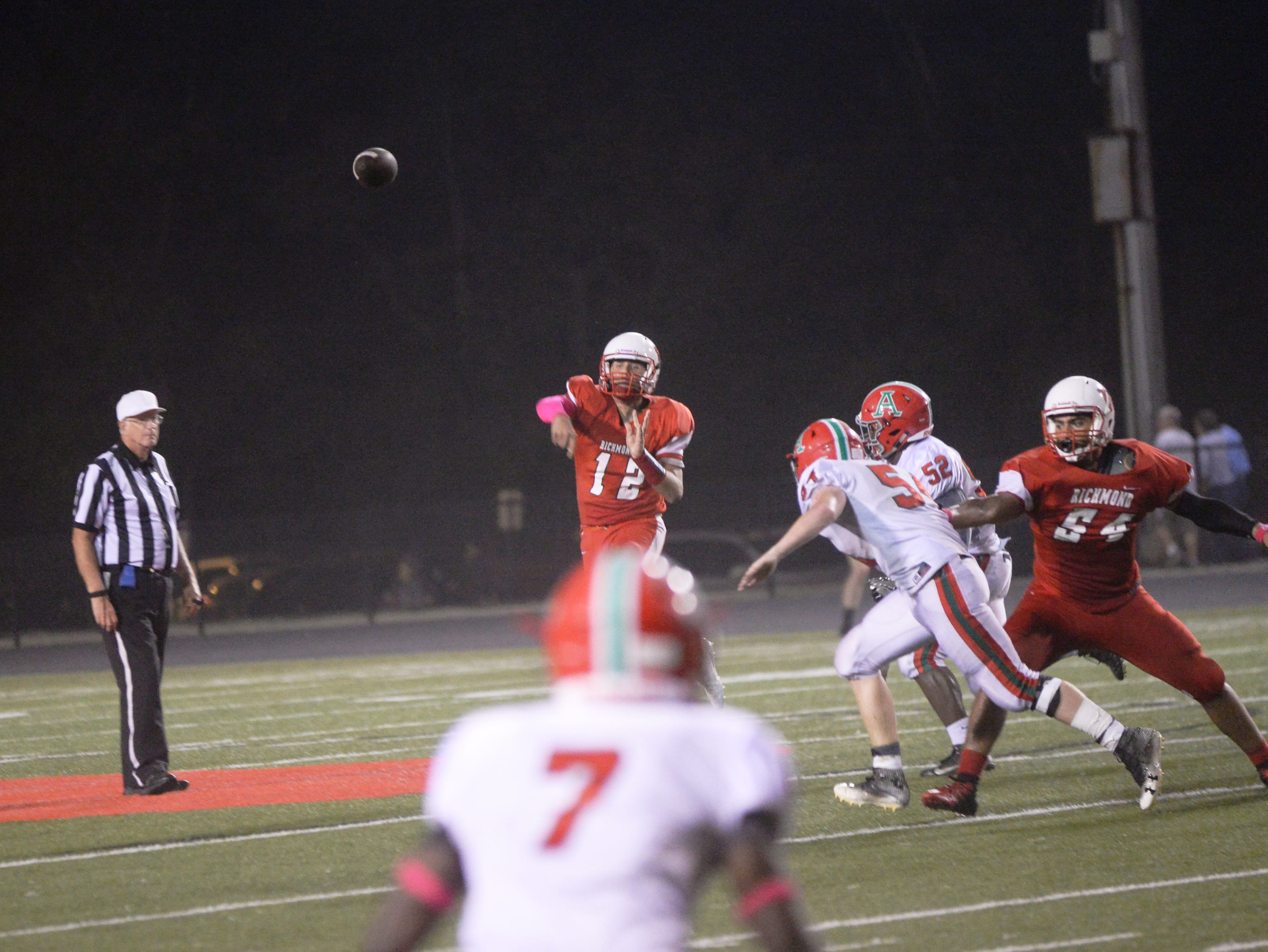 Richmond's Zach Hill (12) throws a pass during the Richmond High School football team's  27-26 loss to Anderson Friday, Oct. 5, 2018 at Lyboult Field.