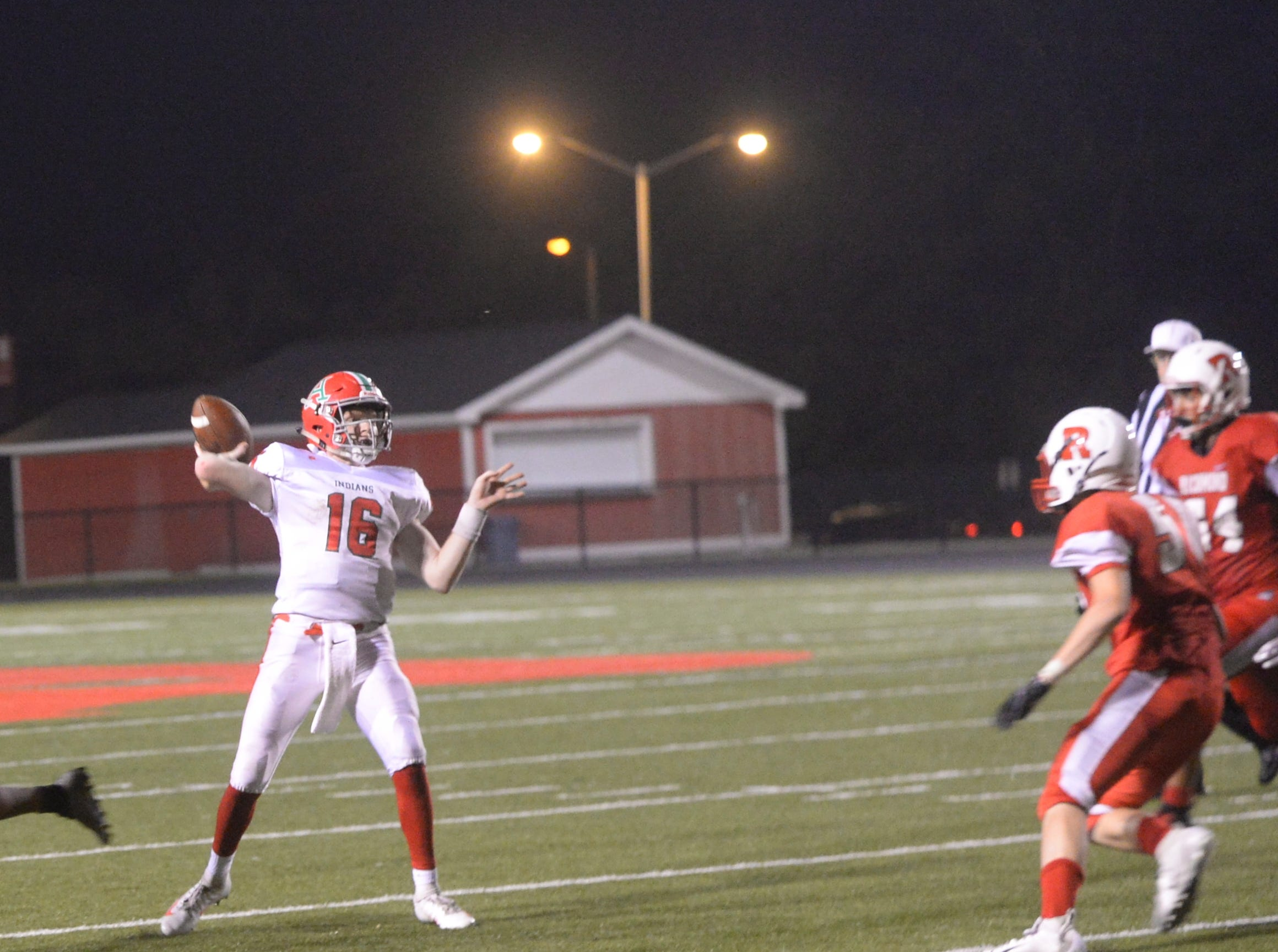 Anderson's Xander Stokes (16) throws a pass during the Richmond High School football team's  27-26 loss to Anderson Friday, Oct. 5, 2018 at Lyboult Field.