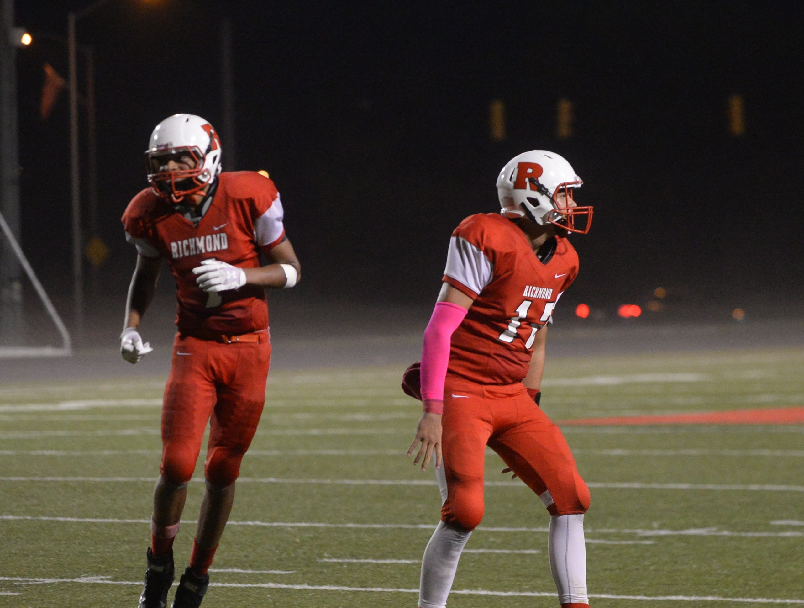 Richmond's Treshawn Jones (1) and Zach Hill (12) celebrate during the Richmond High School football team's  27-26 loss to Anderson Friday, Oct. 5, 2018 at Lyboult Field.
