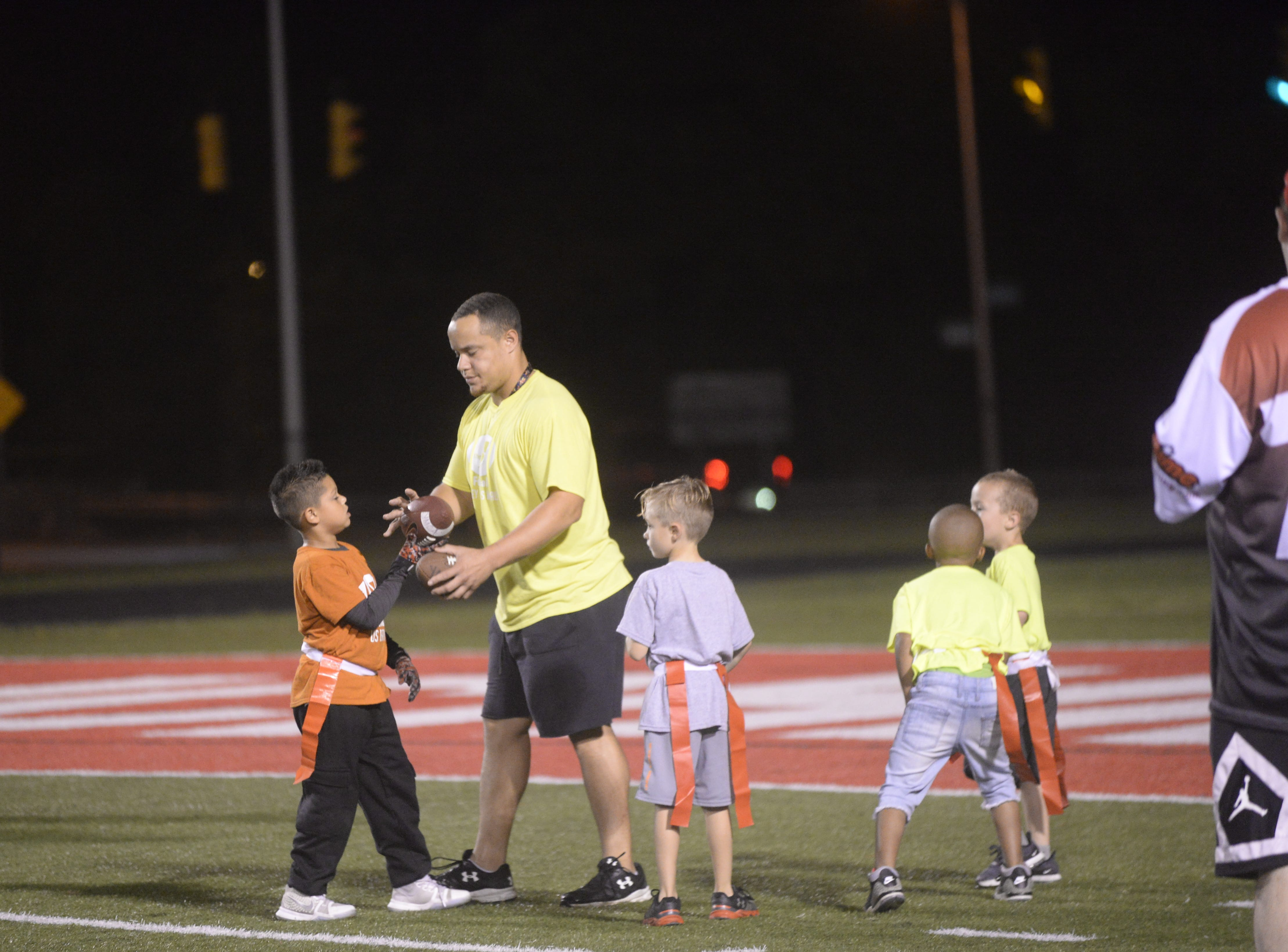 Youth football players play at halftime during the Richmond High School football team's  27-26 loss to Anderson Friday, Oct. 5, 2018 at Lyboult Field.