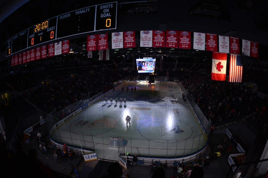 Players for the Rochester Americans and Charlotte Checkers players stand for the national anthem prior to Friday night's American Hockey League season opener at Blue Cross Arena at the Rochester Community War Memorial. Charlotte won 6-2.