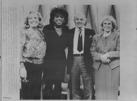 Allen Neuharth, with Oprah Winfrey and two of Neuharth's former wives Lori Wilson, left, and Loretta Neuharth, right