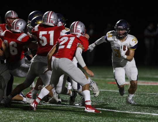 Victor's Joey Pezzimenti tries to get by a host of Canandaigua players unsuccessfully.